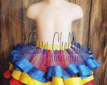 Red, Yellow, And Blue Ribbon Tutu... Snow White Tutu... Superman Tutu... Wonder Woman tutu..