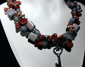 Big and bold necklace, statement choker, Semi precious goldstone,lucite and crystal beads New and trendy!
