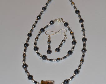 black and silver necklace, bracelet and earring set