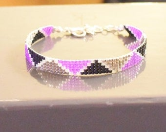 Miyuki Delicas woven bracelet in mauve, black and silver beads