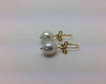 White Baroque pearl earrings, silver 925 gold plated bow