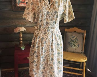 Floral 1960s Pelacco dress in muted blues