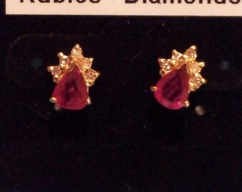 14K Gold Rubies and .10 ct tw Diamonds Earrings