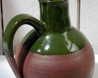Handmade round green pitcher