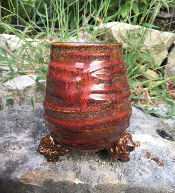 porcelain vase in red, black, and tan