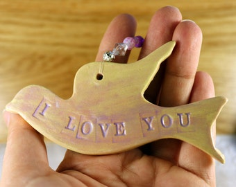 Flying Bird, I Love You, Hanging Decoration, with nice pink glaze in a lovely white gossamer bag. Great for Mothers Day.
