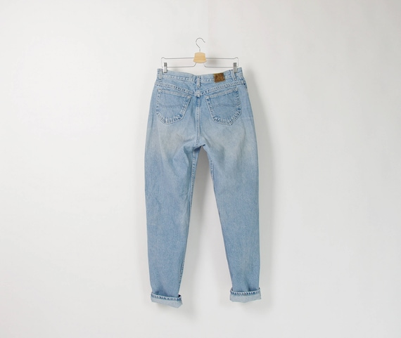80s Lee high waisted tapered legs light blue denim jeans / size w33-34 l34