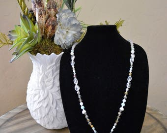 Beautiful necklace with beads and crystals, silver spacers, and a Brighton charm
