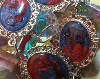 7 1/2 inch OOAK bracelet, silver toned, blue and red.