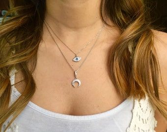 Moon and Eye necklaces.