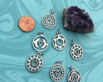 SET 7 CHAKRAS Stainless Steel,Yoga Healing Pendants, Silver Tone, Round Hollow.