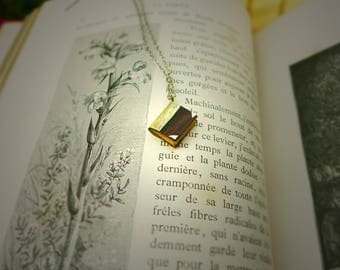 Book necklace made of wood and silver mounted on a silver chain.