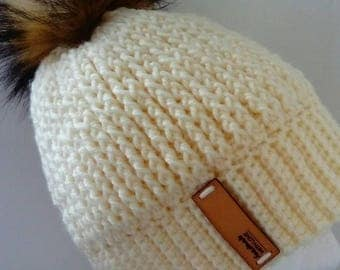 Women's crochet beanie with faux fur pom pom.