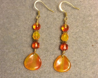Orange and yellow Czech glass rose petal dangle earrings adorned with orange yellow Czech glass beads.