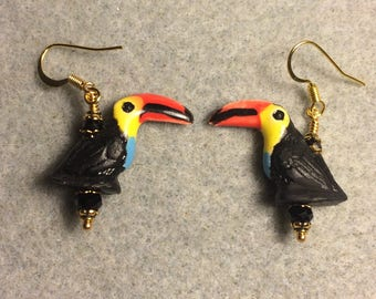 Small black, red, and yellow ceramic toucan bead earrings adorned with black Chinese crystal beads.