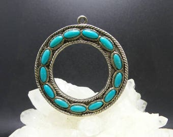 Native American Turquoise and Silver Circle of Life Pendant.