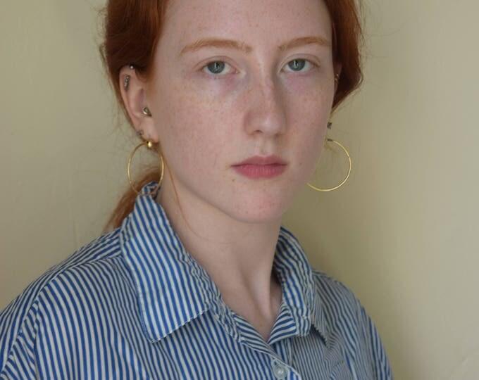 silk striped blouse.