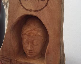 Wooden Buddha Head made has scent