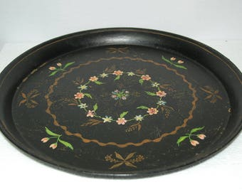 Big  French vintage tole tray in deep black with hand painted flowers in the centre, some crackling, pretty worn effect.