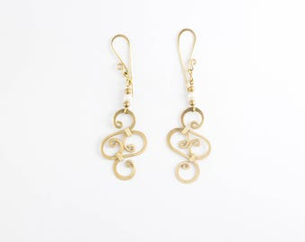Pearl and hammered brass earrings
