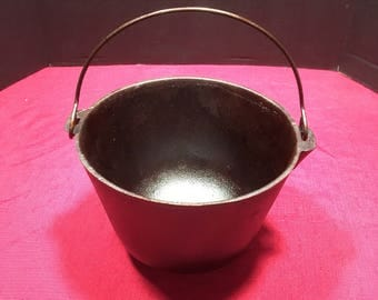 antique three legged castiron kettle