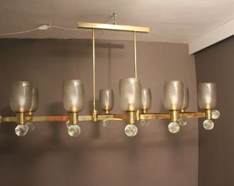 Large Architectural Oval Shaped Brass and Grey Murano Glass Ten-Light Chandelier