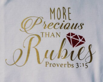 She is More Precious Than Rubies - Proverbs 3:15 Baby Bodysuit - Gold and Red Glitter