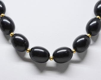 Large black tone beaded necklace