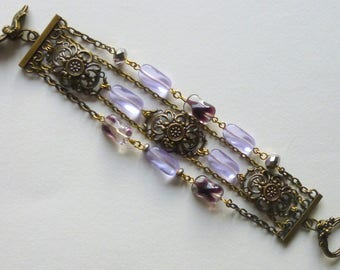 """Bracelet 5 rows, """"Filigree"""" Victorian style, bronze, purple glass beads, filigree cabochons and bronze chains"""