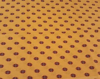 cotton fabric with patterns on yellow background
