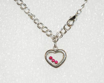 Heart Charm with floating rhinestones on silver bracelet