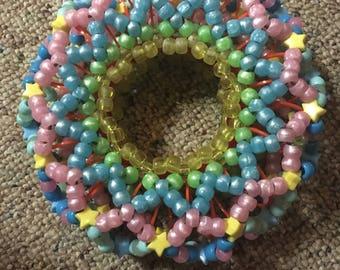 Colorful slinky kandi cuff