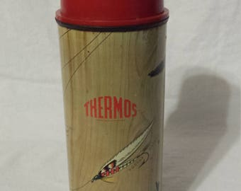 Vintage 1950s A Thermos Brand Vacuum Bottle beverage container with glass liner, brown faux wood  fishing lures, red plastic stopper and cup