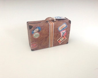 Miniature dollhouse luggage – well-travelled suitcase