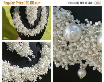 """a necklace, bangle and ear-rings, is """"snow patterns"""""""