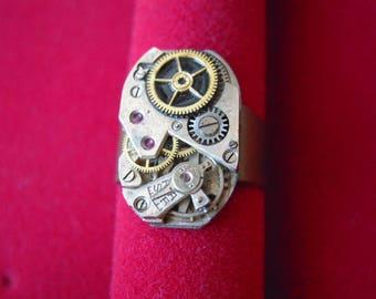 Steampunk ring, vintage watch mechanism, gears and rubies! (B366)