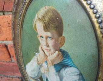 French vintage tin of a boy in sailor suit