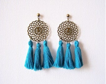 Prints in brass and turquoise blue tassel earrings