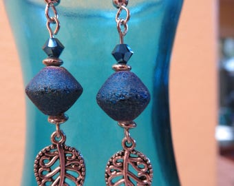 Cobalt blue glass beaded earrings accented with a leaf charm - sterling silver hooks