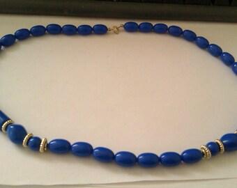 blue plastic bead necklace