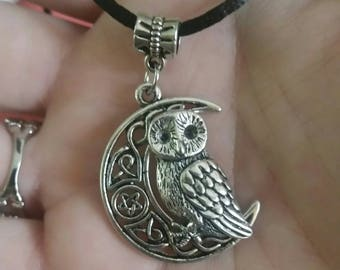 Owl sitting on moon necklace on black rope chain