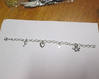 Silver bracelet made with a chain and 4 charms