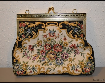 Beautiful, Clutch Purse with a Floral design. With the Opposition to Carry with a Gold Chain.
