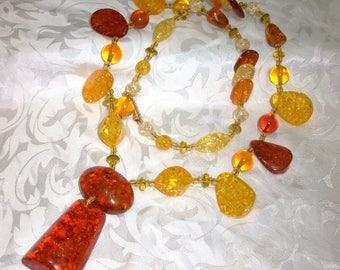 Stunning beaded necklace and medallions of resin and shiny seed beads