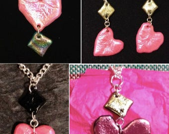Pink, black and gold heart shaped earrings and necklaces