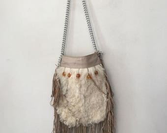 New fur stylish bag , size medium .