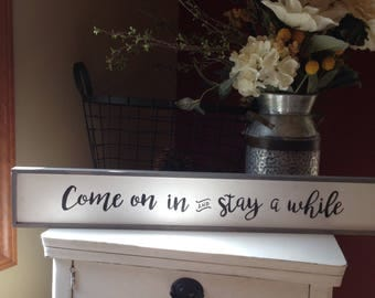 Come on in and stay a while farmhouse welcome sign
