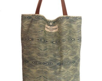 Tote bag in wax and leather straps