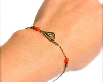 Diamond outline charm bracelet bronze, orange bead