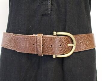 Brown belt; leather belt. Brown leather belt